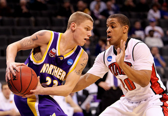 OKLAHOMA CITY - MARCH 18:  Marc Sonnen #23 of the Northern Iowa Panthers looks to pass the ball against Steve Jones #20 of the UNLV Rebels during the first round of the 2010 NCAA men's basketball tournament at Ford Center on March 18, 2010 in Oklahoma Cit