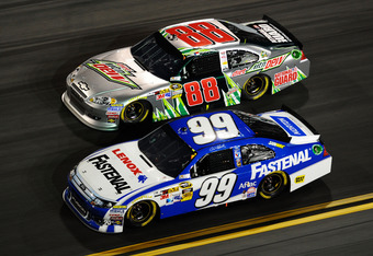 DAYTONA BEACH, FL - FEBRUARY 27:  Carl Edwards, driver of the #99 Fastenal Ford, and Dale Earnhardt Jr., driver of the #88 Diet Mountain Dew/National Guard Chevrolet, race during the NASCAR Sprint Cup Series Daytona 500 at Daytona International Speedway o