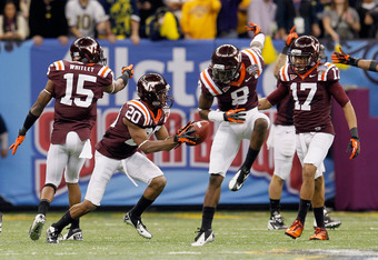 NEW ORLEANS, LA - JANUARY 03:  (L-R) Eddie Whitley #15, Jayron Hosley #20, Detrick Bonner #8 and Kyle Fuller #17 of the Virginia Tech Hokies react after Hosley intercepted a pass, the interception was negated on a pass interference call against Hosley, ag