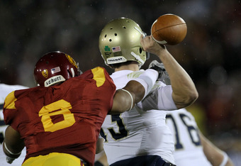 LOS ANGELES - NOVEMBER 27:  Defensive end Nick Perry #6 of the USC Trojans forces a fumble by quarterback Tommy Rees #13 of the Notre Dame Fighting Irish to set up USC's touchdown at the Los Angeles Memorial Coliseum on November 27, 2010 in Los Angeles, C