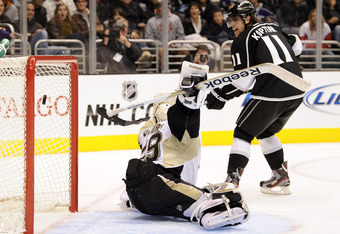 LOS ANGELES, CA - NOVEMBER 05:  Anze Kopitar #11 of the Los Angeles Kings flips the puck over Marc-Andre Fleury #29 of the Pittsburgh Penguins to score a goal for a 1-1 tie during the second period at Staples Center on November 5, 2011 in Los Angeles, Cal