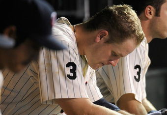 MINNEAPOLIS, MN - AUGUST 23: Justin Morneau #33 and Joe Mauer #7 of the Minnesota Twins sit in the dugout during the eighth inning against the Baltimore Orioles on August 23, 2011 at Target Field in Minneapolis, Minnesota. The Orioles defeated the Twins 8