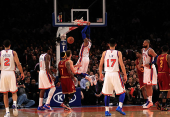NEW YORK, NY - FEBRUARY 29:  Carmelo Anthony #7 of the New York Knicks dunks the ball against the against the Cleveland Cavaliers at Madison Square Garden on February 29, 2012 in New York City. NOTE TO USER: User expressly acknowledges and agrees that, by