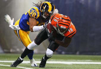 ST. LOUIS, MO - DECEMBER 18: A.J. Green #18 of the Cincinnati Bengals makes a catch against Josh Gordy #38 of the St. Louis Rams at the Edward Jones Dome on December 18, 2011 in St. Louis, Missouri.  The Bengals beat the Rams 20-13.  (Photo by Dilip Vishw
