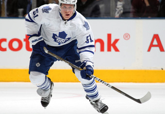 TORONTO, CANADA - FEBRUARY 1:  Jake Gardiner #51 of the Toronto Maple Leafs heads up ice with the puck in a game against the Pittsburgh Penguins on February 1,2012 at the Air Canada Centre in Toronto, Canada. The Leafs defeated the Penguins 1-0. (Photo by
