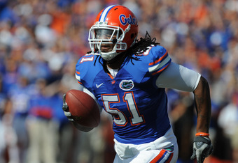 GAINESVILLE, FL - NOVEMBER 21: Linebacker Brandon Spikes #51 of the Florida Gators returns an interception 40 yards for a first-quarter touchdown against the Florida International University Golden Panthers, November 21, 2009 at Ben Hill Griffin Stadium i