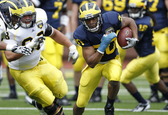 ANN ARBOR, MI - APRIL 16: Michael Shaw #20 runs for a short gain during the annual Spring Game at Michigan Stadium on April 16, 2011 in Ann Arbor, Michigan.  (Photo by Leon Halip/Getty Images)