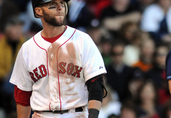 BOSTON, MA - SEPTEMBER 18:  Dustin Pedroia #15 of the Boston Red Sox walks back to the dugout after striking out in the eighth inning against the Tampa Bay Rays at Fenway Park on September 18, 2011 in Boston, Massachusetts. The Rays won the game 8-5. (Pho