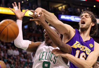 BOSTON - JUNE 10:  Pau Gasol #16 of the Los Angeles Lakers disruptes a shot attempt by Rajon Rondo #9 of the Boston Celltics during Game Four of the 2010 NBA Finals on June 10, 2010 at TD Garden in Boston, Massachusetts. NOTE TO USER: User expressly ackno