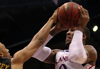 LAWRENCE, KS - FEBRUARY 25:  Thomas Robinson #0 of the Kansas Jayhawks shoots as Matt Pressey #3 of the Missouri Tigers defends during the game on February 25, 2012 at Allen Fieldhouse in Lawrence, Kansas.  (Photo by Jamie Squire/Getty Images)