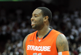 LOUISVILLE, KY - FEBRUARY 13:  Scoop Jardine#11 of the Syracuse Orange is all smiles as he walks off of the court after the Orange beat the Louisville Cardinals 52-51 in the Big East Conference game at KFC YUM! Center on February 13, 2012 in Louisville, K