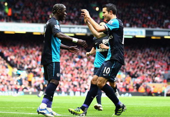 LIVERPOOL, ENGLAND - MARCH 03:  Robin van Persie of Arsenal celebrates scoring the equalising goal with teammate Bacary Sagna (L) during the Barclays Premier League match between Liverpool and Arsenal at Anfield on March 3, 2012 in Liverpool, England.  (P