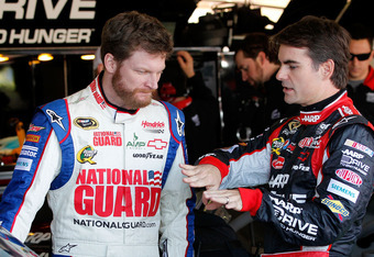 AVONDALE, AZ - MARCH 02:  (L-R) Dale Earnhardt Jr., driver of the #88 National Guard/ Diet Mountain Dew Chevrolet, talks with Jeff Gordon, driver of the #24 Drive to End Hunger Chevrolet, in the garage area prior to practice for the NASCAR Sprint Cup Seri