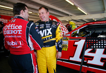 AVONDALE, AZ - MARCH 02:  Tony Stewart, driver of the #14 Office Depot/ Mobil 1 Chevrolet, talks with Ryan Newman, driver of the #39 Wix Filters Chevrolet, in the garage prior to practice for the NASCAR Nationwide Series Bashas' Supermarkets 200 at Phoeni