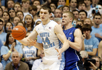 CHAPEL HILL, NC - FEBRUARY 08:  Tyler Zeller #44 of the North Carolina Tar Heels drives to the basket against Mason Plumlee #5 of the Duke Blue Devils during their game at the Dean Smith Center on February 8, 2012 in Chapel Hill, North Carolina.  (Photo b
