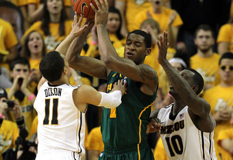 COLUMBIA, MO - FEBRUARY 11:  Michael Dixon #11 and Ricardo Ratliffe #10 of the Missouri Tigers double-team Perry Jones III #1 of the Baylor Bears during the game on February 11, 2012  at Mizzou Arena in Columbia, Missouri.  (Photo by Jamie Squire/Getty Im