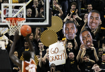 COLUMBIA, MO - JANUARY 14:  Fans hold giant signs depicting the faces of Ricardo Ratliffe #10, Steve Moore #32, and Matt Pressey #3 of the Missouri Tigers as Alexis Wangmene #20 of the Texas Longhorns shoots a free throw during the game on January 14, 201