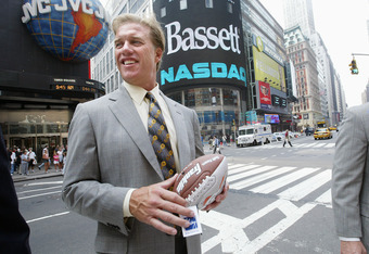 NEW YORK - AUGUST 11:  Hall of Fame quarterback John Elway stands outside the NASDAQ MarketSite August 11, 2004 in New York City. Elway was invited to the Market Open to celebrate The John Elway Home Collection, a new line of home entertainment and reclin