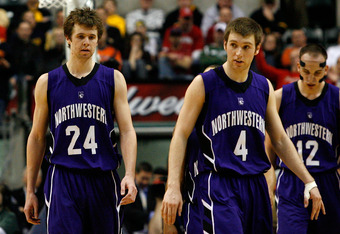 INDIANAPOLIS, IN - MARCH 11:  (L-R) John Shurna #24, Alex Marcotullio #4 and Luka Mirkovic #12 of the Northwestern Wildcats walk up court dejected during overtime against the Ohio State Buckeyes during the quarterfinals of the 2011 Big Ten Men's Basketbal
