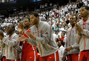EAST LANSING, MI - MARCH 04:  The Ohio State Buckeyes bench celebrates a win over the Michigan State Spartans 72-70 for a share of the Big Ten Title during the game at Breslin Center on March 4, 2012 in East Lansing, Michigan.  (Photo by Leon Halip/Getty