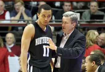 BLOOMINGTON, IL - FEBRUARY 15: Bill Carmody the head coach of the Northwestern Wildcats talks with Reggie Hearn #11 during the Big Ten Conference game against the Indiana Hoosiers at Assembly Hall on February 15, 2012 in Bloomington, Indiana.  (Photo by A