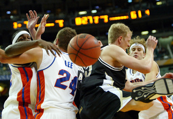 ATLANTA - MARCH 13:  Matt Freije #35 of the Vanderbilt Commadores crashes into Chris Richard #32, David Lee #24 and Matt Walsh #44 of the Florida Gators as the Gators defeated the Commadores 91-69 during the semifinals of the SEC Men's Basketball Tourname