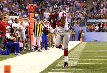 INDIANAPOLIS, IN - FEBRUARY 05:  Mario Manningham #82 of the New York Giants attempts to make a catch against the New England Patriots during Super Bowl XLVI at Lucas Oil Stadium on February 5, 2012 in Indianapolis, Indiana.  (Photo by Al Bello/Getty Imag