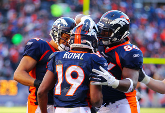 DENVER, CO - JANUARY 08:  Eddie Royal #19 of the Denver Broncos celebrates with his teammates after catching a touchdown pass in the second quarter against the Pittsburgh Steelers during the AFC Wild Card Playoff game at Sports Authority Field at Mile Hig