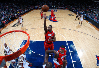 ATLANTA, GA - FEBRUARY 12:  Joe Johnson #2 of the Atlanta Hawks shoots against the Miami Heat at Philips Arena on February 12, 2012 in Atlanta, Georgia.  NOTE TO USER: User expressly acknowledges and agrees that, by downloading and or using this photograp