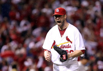 ST LOUIS, MO - OCTOBER 12:  Starting pitcher Chris Carpenter #29 of the St. Louis Cardinals reacts after a strike out against the Milwaukee Brewers during Game Three of the National League Championship Series at Busch Stadium on October 12, 2011 in St Lou