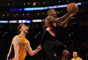 LOS ANGELES, CA - FEBRUARY 20:  Jamal Crawford #11 of the Portland Trail Blazers scores on a layup past Pau Gasol #16 of the Los Angeles Lakers during the second half at Staples Center on February 20, 2012 in Los Angeles, California. The Lakers won 103-92