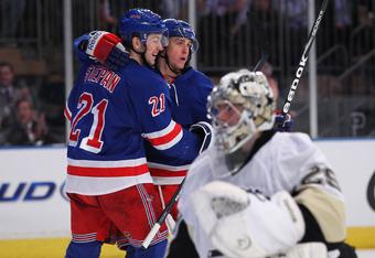 Stepan and Hagelin celebrate a goal.