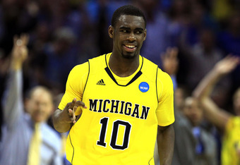 CHARLOTTE, NC - MARCH 20:  Tim Hardaway Jr. #10 of the Michigan Wolverines reacts after making a three-pointer in the second half while taking on the Duke Blue Devils during the third round of the 2011 NCAA men's basketball tournament at Time Warner Cable