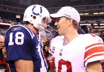 INDIANAPOLIS - SEPTEMBER 19:  Eli Manning #10 of the New York Giants and Peyton Manning #18 of the Indianapolis Colts embrace following the Colts 38-14 win at Lucas Oil Stadium on September 19, 2010 in Indianapolis, Indiana.  (Photo by Andy Lyons/Getty Im