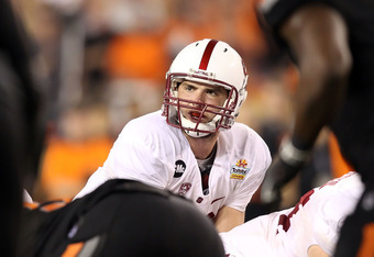 GLENDALE, AZ - JANUARY 02:  Andrew Luck #12 of the Stanford Cardinal prepares to snap the football during the Tostitos Fiesta Bowl against the Oklahoma State Cowboys on January 2, 2012 at University of Phoenix Stadium in Glendale, Arizona.  (Photo by Chri