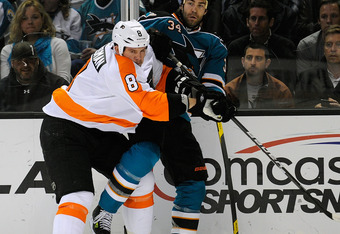 SAN JOSE, CA - FEBRUARY 28:  Nicklas Grossman #8 of the Philadelphia Flyers collides with Daniel Winnik #34 of the San Jose Sharks at HP Pavilion at San Jose on February 28, 2012 in San Jose, California.  (Photo by Thearon W. Henderson/Getty Images)