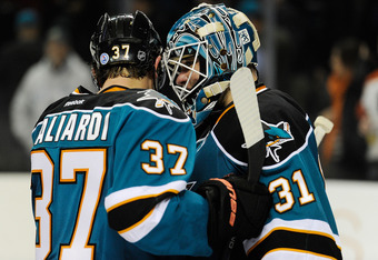 SAN JOSE, CA - FEBRUARY 28: TJ Galiardi #37 and Goaltender Antti Niemi #31 of the San Jose Sharks celebrates after they defeated the Philadelphia Flyers 1 to 0 at HP Pavilion at San Jose on February 28, 2012 in San Jose, California.  (Photo by Thearon W.