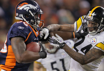 DENVER, CO - JANUARY 08:  Demaryius Thomas #88 of the Denver Broncos makes a pass reception and fights off Ike Taylor #24 of the Pittsburgh Steelers to go 80 yards for the game winning touchdown on the first play of overtime at Sports Authority Field at M