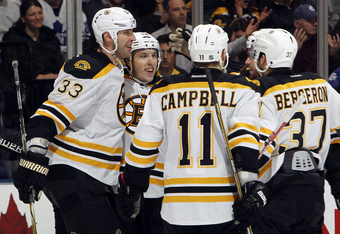 TORONTO, CANADA - MARCH 6: The Boston Bruins celebrate Jordan Caron goal against the Toronto Maple Leafs during NHL action at the Air Canada Centre March 6, 2012 in Toronto, Ontario, Canada. (Photo by Abelimages/Getty Images)