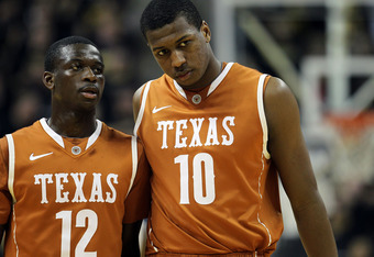 COLUMBIA, MO - JANUARY 14:  Myck Kabongo #12 and Jonathan Holmes #10 of the Texas Longhorns walk onto the court after a timeout during the game against the Missouri Tigers on January 14, 2012 at Mizzou Arena in Columbia, Missouri.  (Photo by Jamie Squire/