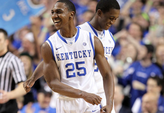 LEXINGTON, KY - FEBRUARY 18:  Marquis Teague #25 and Doron Lamb #20 of the Kentucky Wildcats  celebrate during the game against the Ole Miss Rebels at Rupp Arena on February 18, 2012 in Lexington, Kentucky.  (Photo by Andy Lyons/Getty Images)