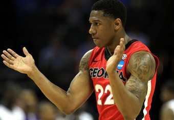 CHARLOTTE, NC - MARCH 18:  Gerald Robinson #22 of the Georgia Bulldogs reacts in the first half while taking on the Washington Huskies during the second round of the 2011 NCAA men's basketball tournament at Time Warner Cable Arena on March 18, 2011 in Cha