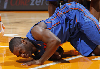 KNOXVILLE, TN - JANUARY 7: Erving Walker #11 of the Florida Gators reacts after being knocked to the floor during the game against the Tennessee Volunteers at Thompson-Boling Arena on January 7, 2012 in Knoxville, Tennessee. Tennessee defeated Florida 67-