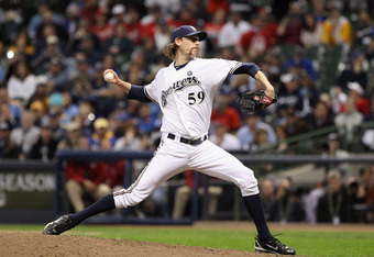 MILWAUKEE, WI - OCTOBER 16:  John Axford #59 of the Milwaukee Brewers throws a pitch against the St. Louis Cardinals during Game Six of the National League Championship Series at Miller Park on October 16, 2011 in Milwaukee, Wisconsin.  (Photo by Christia