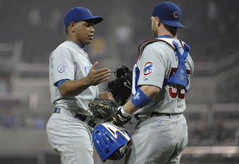 SAN DIEGO, CA - SEPTEMBER 27:  Carlos Marmol #49 of the Chicago Cubs, right, is congratulated by Koyie Hill #55 after getting the final out during the ninth inning of a baseball game against the San Diego Padres at Petco Park on September 27, 2011 in San