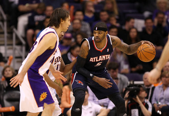 PHOENIX, AZ - FEBRUARY 15:  Josh Smith #5 of the Atlanta Hawks handles the ball during the NBA game against the Phoenix Suns at US Airways Center on February 15, 2012 in Phoenix, Arizona. The Hawks defeated the Suns 101-99.  NOTE TO USER: User expressly a