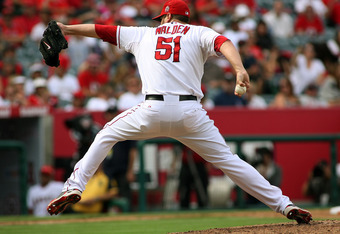 ANAHEIM, CA - SEPTEMBER 25:  Jordan Walden #51 of the Los Angeles Angels of Anaheim pitches against the Oakland Athletics in the ninth inning at Angel Stadium of Anaheim on September 25, 2011 in Anaheim, California.  (Photo by Jeff Golden/Getty Images)