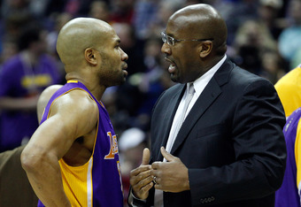WASHINGTON, DC - MARCH 07: Derek Fisher #2 of the Los Angeles Lakers talks with head coach Mike Brown during the second half against the Washington Wizards at the Verizon Center on March 7, 2012 in Washington, DC. NOTE TO USER: User expressly acknowledges