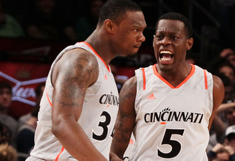 """Senior Yancy Gates and Sophomore Justin """"Worm"""" Jackson celebrate during UC's first quarterfinal comeback win over #14 Georgetown at the Big East Championship"""