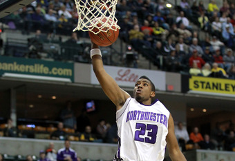 INDIANAPOLIS, IN - MARCH 08:  JerShon Cobb #23 of the Northwestern Wildcats attempts a dunk against the Minnesota Golden Gophers during their first round game of 2012 Big Ten Men's Basketball Conferene Tournament at Bankers Life Fieldhouse on March 8, 201